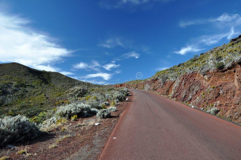 Bijeenkomsteiland - weg aan de vulkaan stock afbeelding