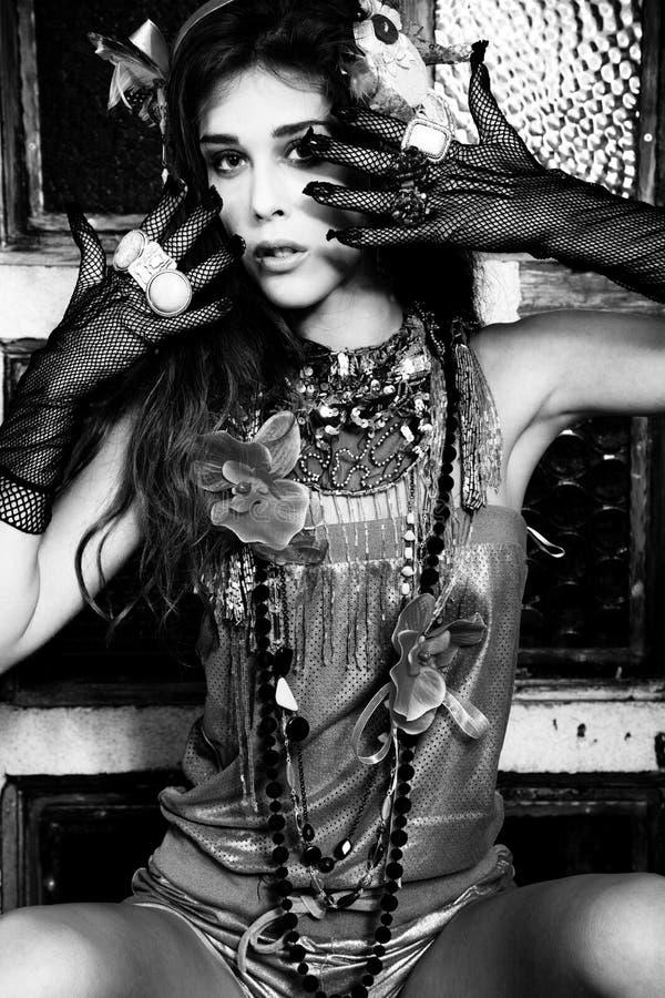 Bijou. Young beautiful woman wearing lot of bijou, indoor shot royalty free stock photos