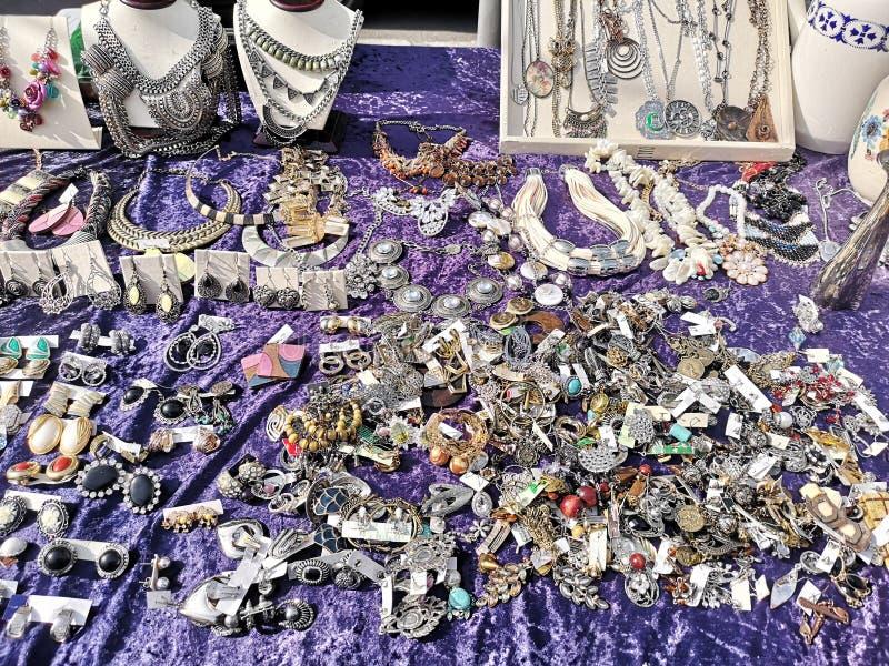 Bijou 111346. Bijou on purple velvet tablecloth on flea market stock photography
