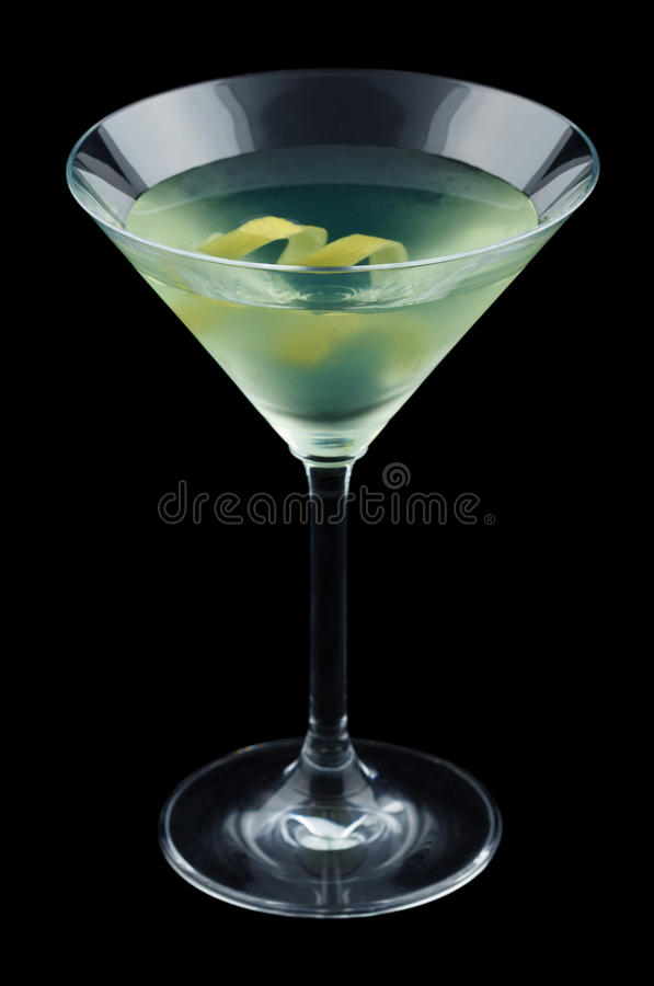 Bijou cocktail with lemon twist isolated on black background. Bijou is a classic cocktail that contains gin, green chartreuse, sweet vermouth and orange bitters stock images