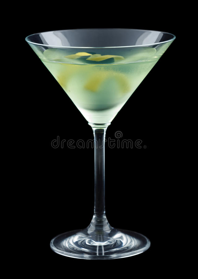 Bijou cocktail with lemon twist isolated on black background. Bijou is a classic cocktail that contains gin, green chartreuse, sweet vermouth and orange bitters royalty free stock photo