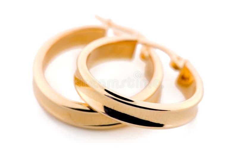 Bijou d'or - boucles d'oreille photographie stock