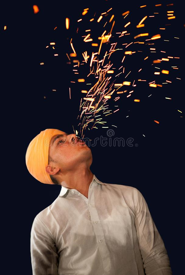 Indian fakir, fire eater performing fire eating during festival in Bikaner, India royalty free stock photos