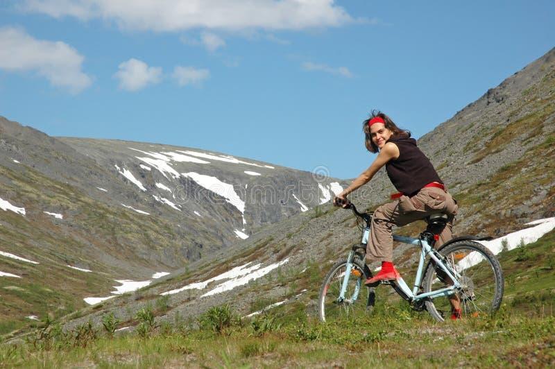 Bike adventure #6. Bike adventure! #6. Girl biking in high mountains stock images