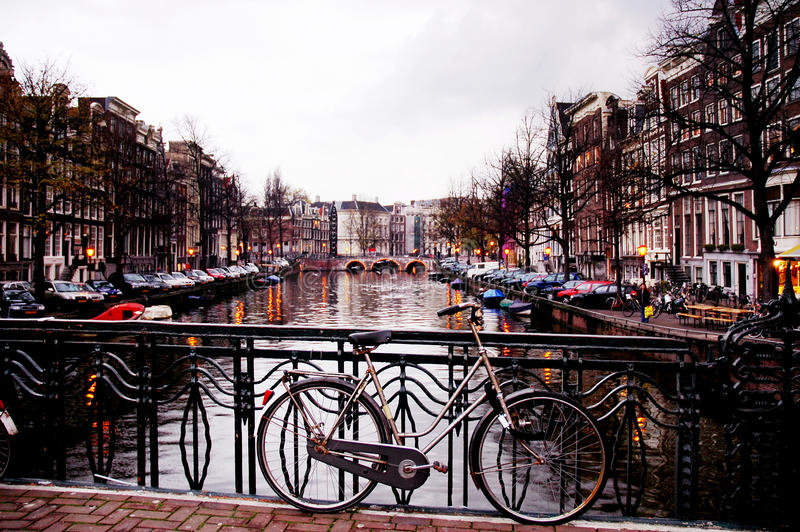 Bike Against a Bridge by Nightfall, Amsterdam royalty free stock photography