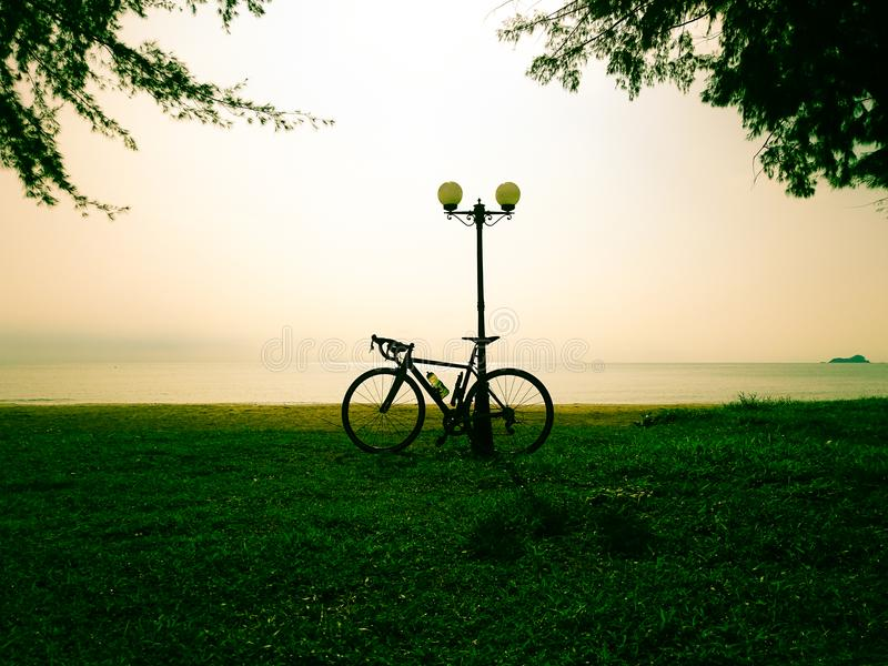 Bike on meadow and sea view stock photography
