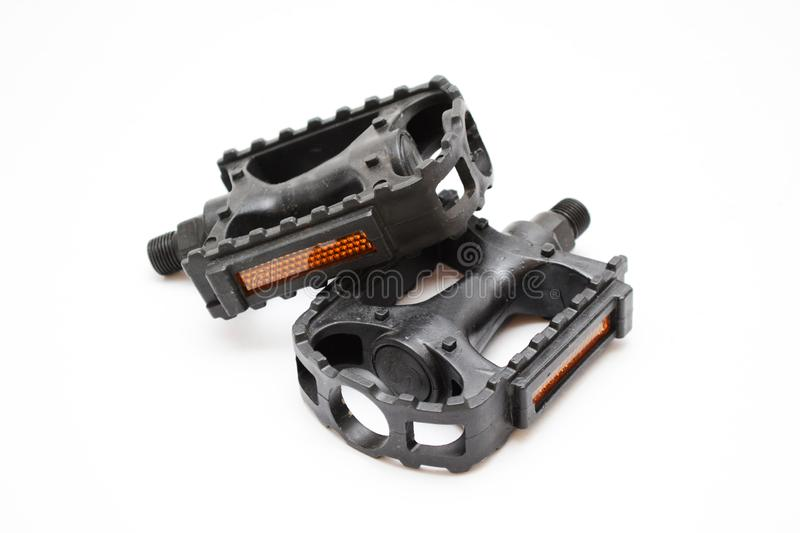 Bike Bicycle pedals  isolated on white. Bicycle pedal isolated on white background. Picture contains two pedals with reflective cat eyes royalty free stock photo