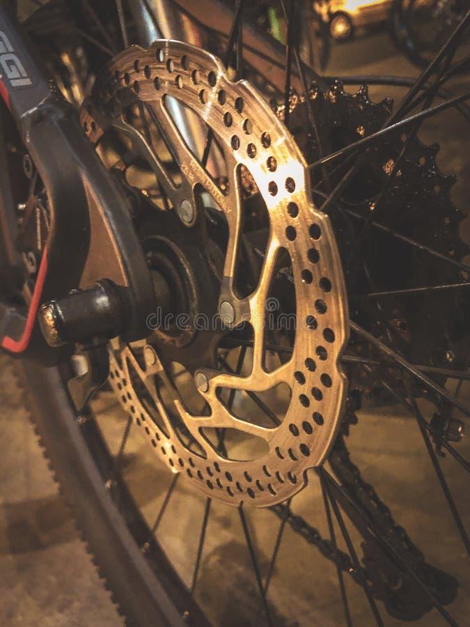Shiny bike brake wheel. A shiny hydraulic rear disc brake stock photos