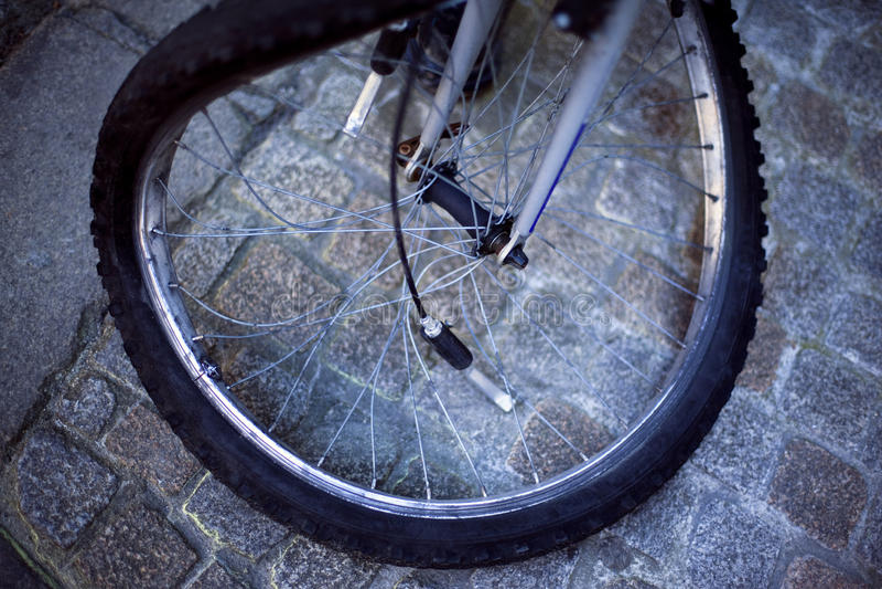 Bike. Broken wheel bike in a paved street royalty free stock photography