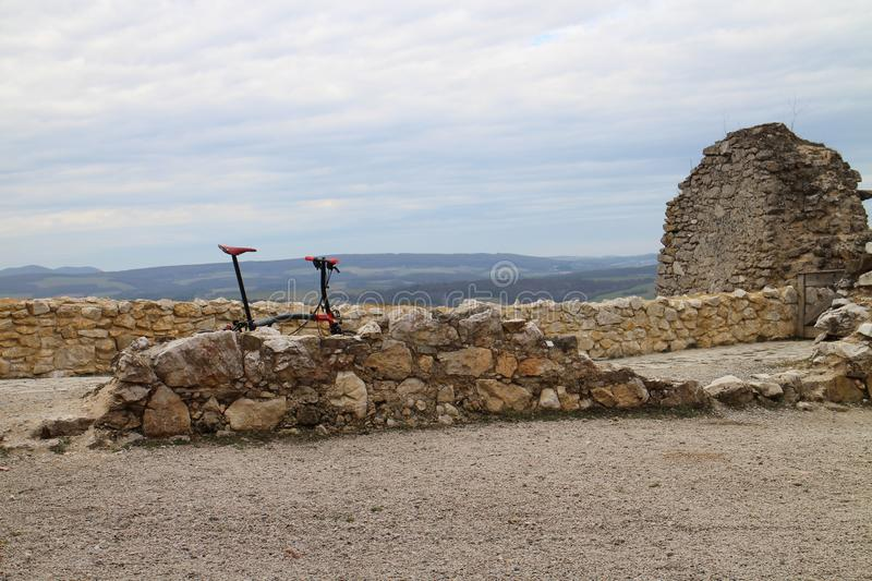 Bike on Castle of Countess Elisabeth Báthory, Čachtice stock photography