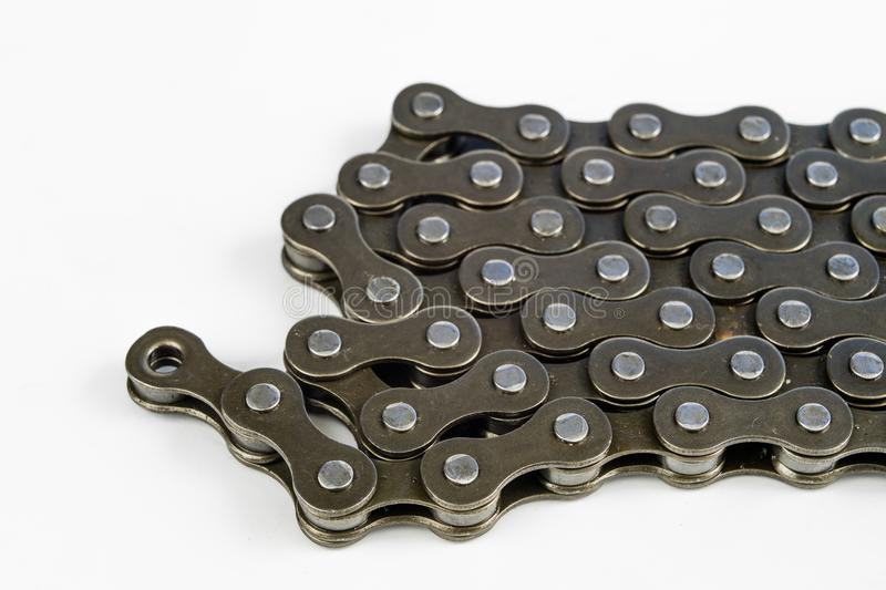 Bike chain arranged on a white table. Periodic servicing of part. S for two-wheelers. Light background royalty free stock photos