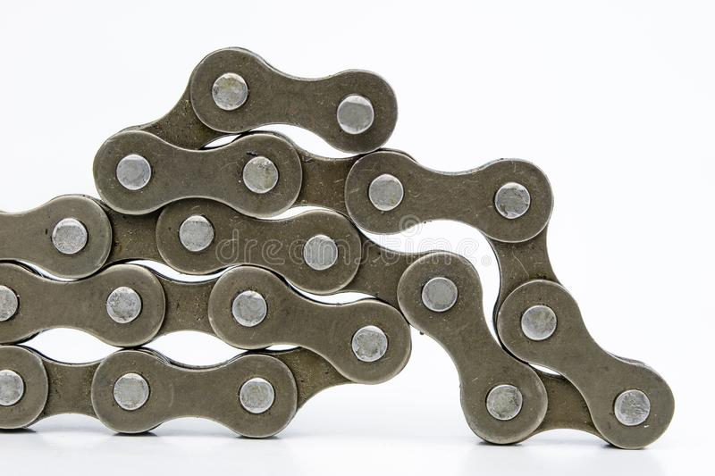 Bike chain arranged on a white table. Periodic servicing of part. S for two-wheelers. Light background royalty free stock image
