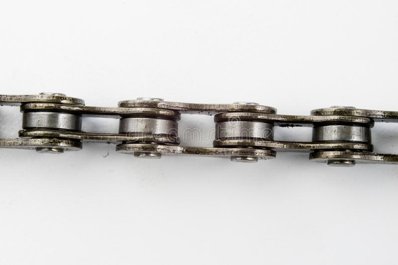 Bike chain arranged on a white table. Periodic servicing of part. S for two-wheelers. Light background stock photos