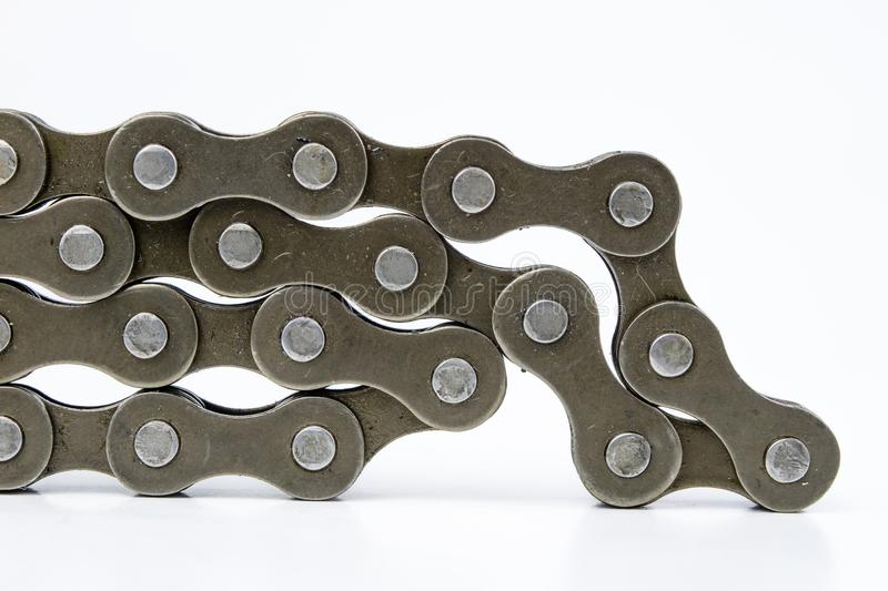 Bike chain arranged on a white table. Periodic servicing of part. S for two-wheelers. Light background royalty free stock images