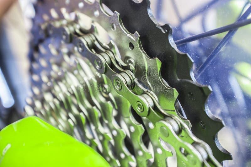 Bike chain links over chainrings on MTB. Closeup. Selectuiva focus stock photo