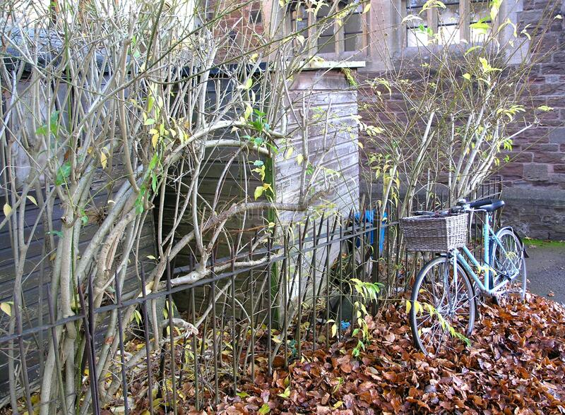Bike by a church wall royalty free stock photos