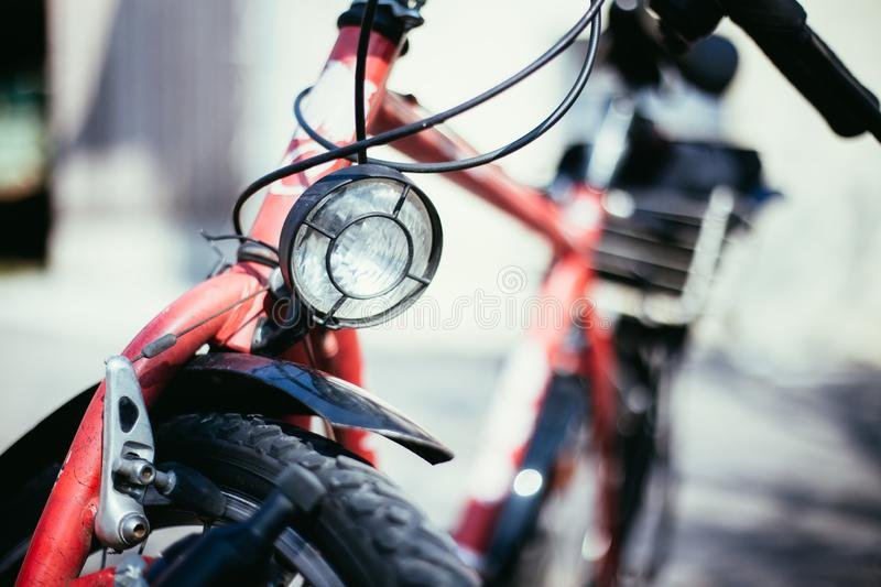 Bike in the city: Front picture of a city bike, blurred background. Front picture of a city bike, head lamp and blurry background bicycle mobility urban tour stock photo