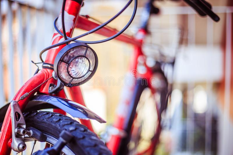 Bike in the city: Front picture of a city bike, blurred background. Front picture of a city bike, head lamp and blurry background bicycle mobility urban tour stock photos