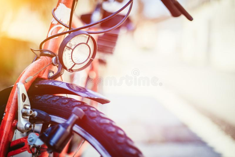 Bike in the city: Front picture of a city bike, blurred background. Front picture of a city bike, head lamp and blurry background bicycle mobility urban tour stock photography