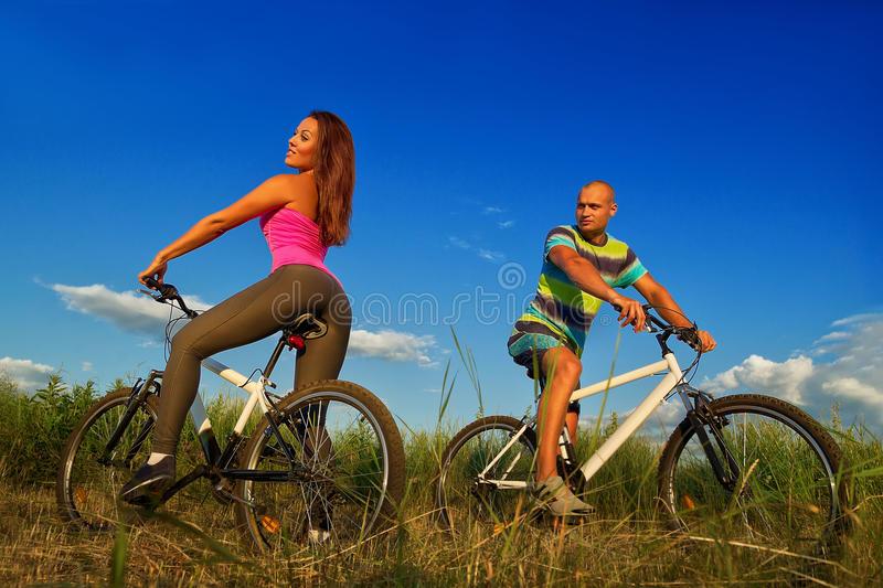 Download Bike couple stock photo. Image of action, grass, biking - 33622200