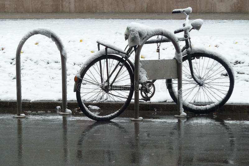 Bike covered with snow. On the street royalty free stock images