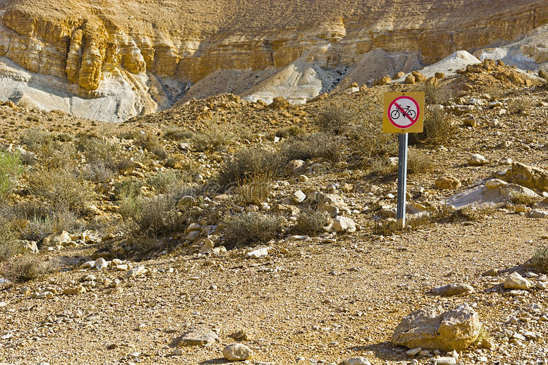 Bike in Desert. Road Sign Prohibiting Riding a Bike in the Desert royalty free stock images