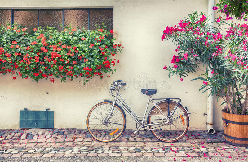 Bike in France village. Summer background of france bike and flowers stock photo