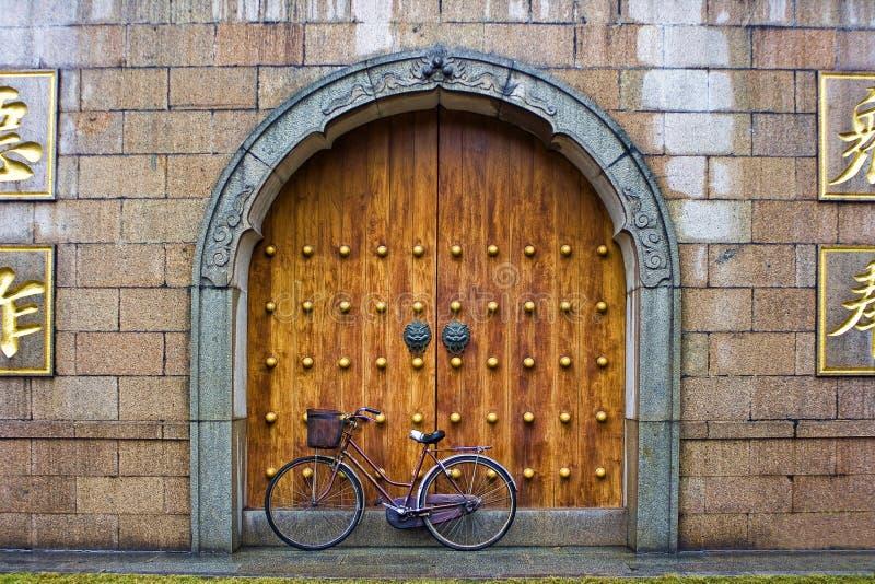 Bike in front of temple door stock images