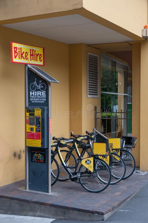 Bike hire station. Sustainable green transport sharing. Sydney, Australia - November 18, 2018: Bike hire station in Sydney CBD. Sustainable transport sharing stock image