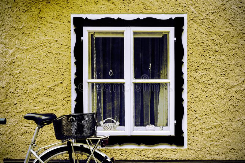 Bike at home in the Austrian city of Hallstatt. On a rainy day. Typical window of a house in a small town in Austria. Retro style stock photos