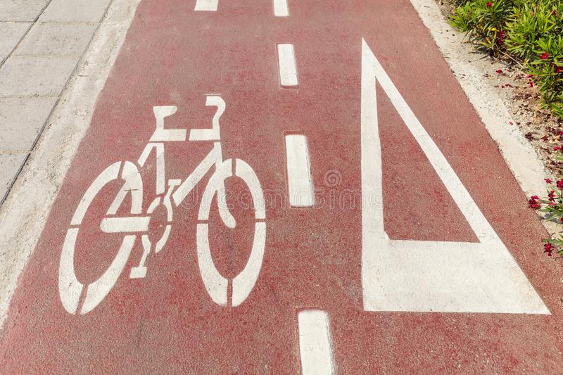 Bike lane. Bicycle sign and white directional arrow royalty free stock photography