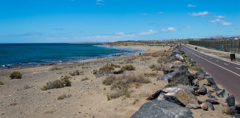 Bike Lane in Lanzarote. Bike lane along Playa Honda beach in Lanzarote, Canary Island, Spain. This bike lane run along the international airport and it`s coasted stock images