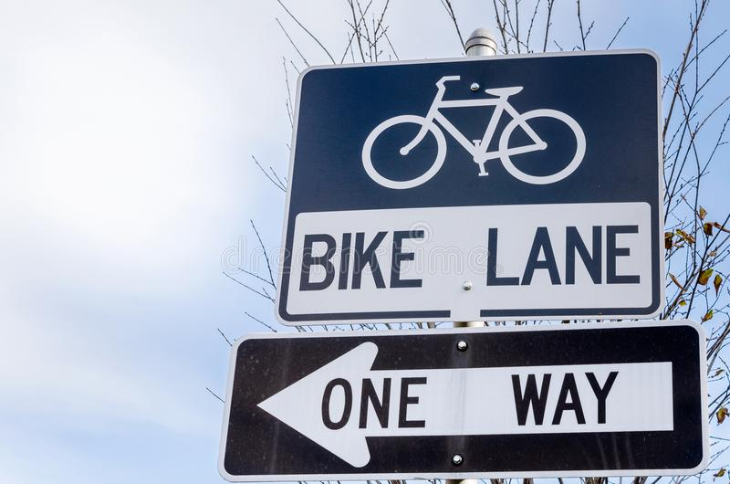 Bike Lane and One Way Signs stock photos