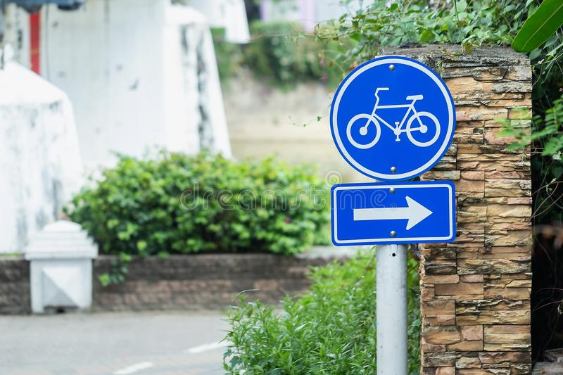 Bike lane and bike sign in middle of park Cyclists always spend their time on bicycles. royalty free stock images