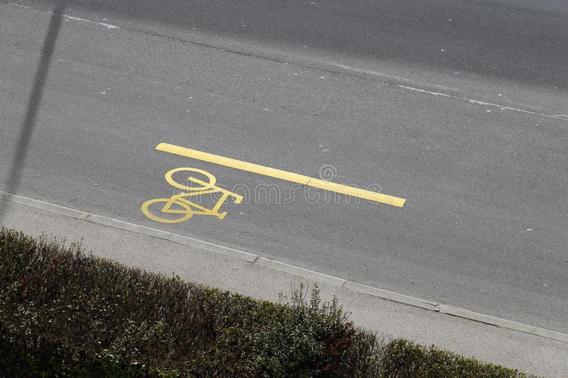 Bike Line Marked with a Yellow Bicycle Sign royalty free stock photo