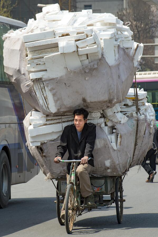 Free Bike Loaded With Much Stapled Polystyrene Material, Xi&x27;an, China. Chinese Bicycle Driver Riding With Much Loaded Polystyrene. Stock Image - 175426121