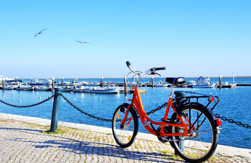Bike parked along the port of Algarve. Sea royalty free stock photos