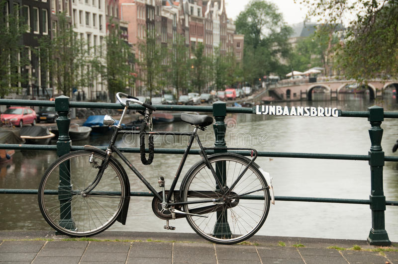 Bike parked on a bridge royalty free stock image