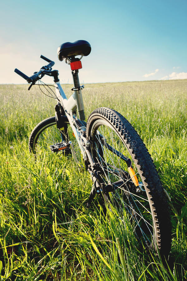 Bike parked in a meadow. With blue sky royalty free stock photos