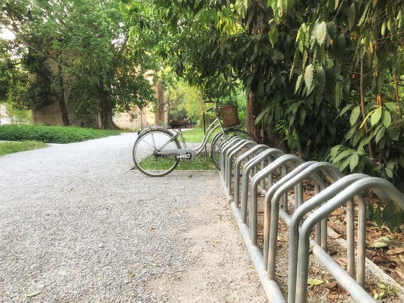 The bike is parked in a park in the backyard of a country house that is safe  and reducing global warming. The bike is parked in a park in the backyard of a stock image