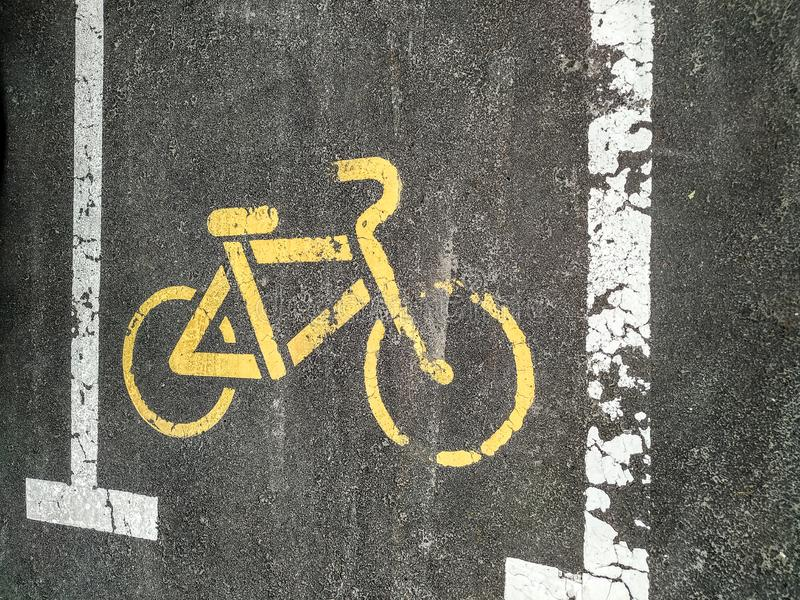 Bike parking sign on the tarmac. Road signs. Traffic, asphalt, street, transport, urban, highway, warning, background, city, paint, safety, black, symbol stock image