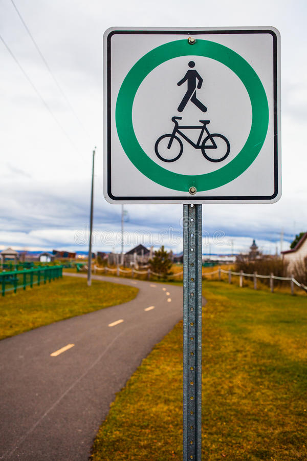 Bike and Pedestrian Path Sign and Blurry Track stock images