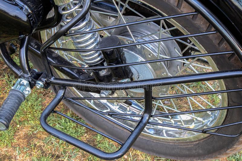 Bike rear tire and footrest. Stand stock photography