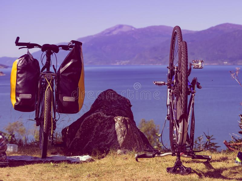 Bike repair against nature fjord, Norway. Bike repair. Mountain bicycle with saddlebag against nature, mountains fjord landscape in Norway stock photos