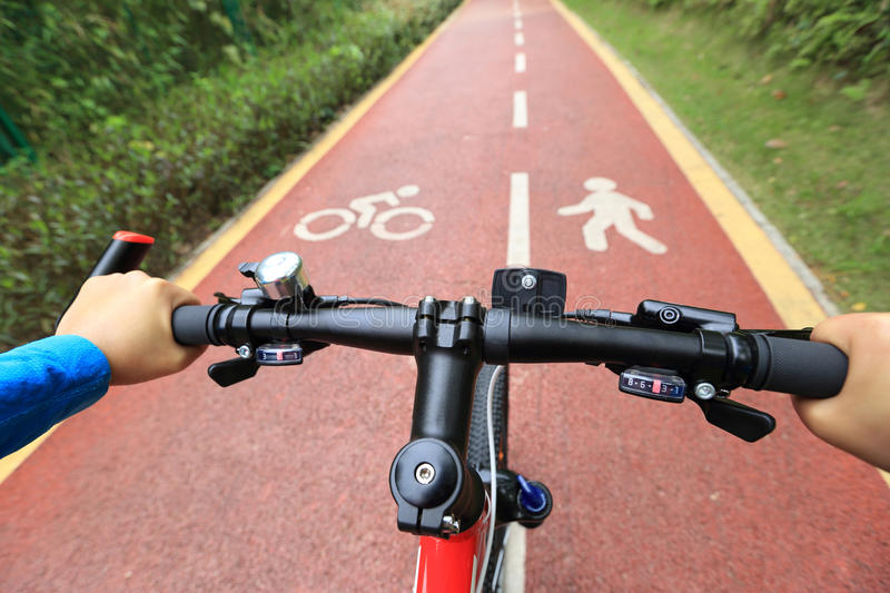 Bike ride in the forest. View from bikers eyes royalty free stock photos