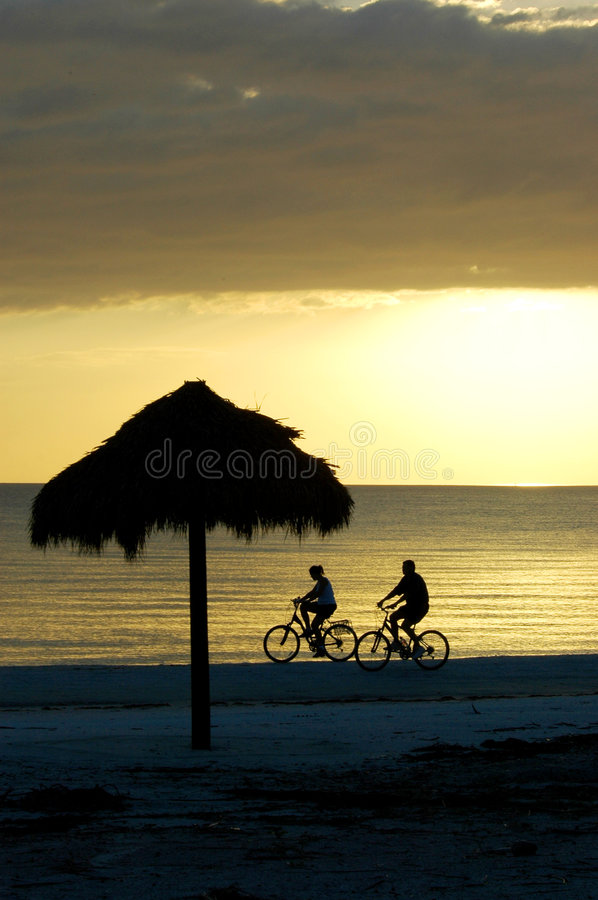 Free Bike Riding Couple On Fort Myers Beach Royalty Free Stock Images - 331389