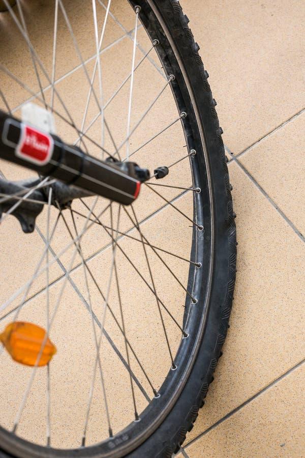Bike's flat tire. On stone floor stock image