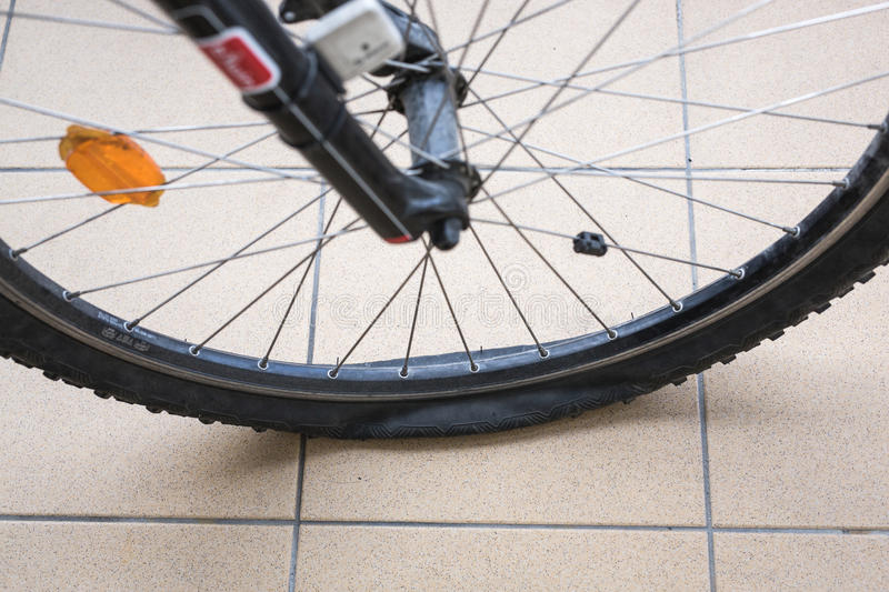 Bike's flat tire. On stone floor royalty free stock images