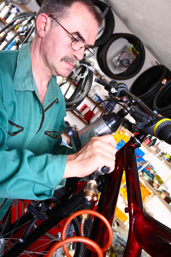 Bike service. Service for bike with adept repairing bike royalty free stock photos