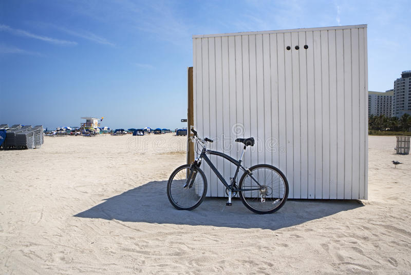 Bike in Shaded Sand. A mountain bike sits in the shaded sand of Miami's South Beach early in the morning royalty free stock photos